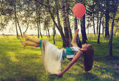 Woman levitating in the forest — Stock Photo