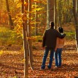 Young couple in forest while autumn — Stock Photo #59818831