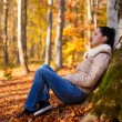 Woman relaxing in nature while autumn season — Stock Photo #59819481