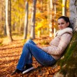 Woman relaxing in nature while autumn season — Stock Photo #59822837