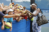 Nine times Grand Slam champion Venus Williams signing autographs after practice for US Open 2014 — Stock Photo