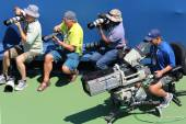 Professional photographers and TV camera man at US Open 2014 at Billie Jean King National Tennis Center — Stock Photo