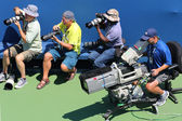 Professional photographers and TV camera man at US Open 2014 at Billie Jean King National Tennis Center — Стоковое фото
