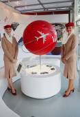 Emirates Airlines flight attendants at the Emirates Airlines booth at the Billie Jean King National Tennis Center during US Open 2014 — Stock Photo