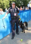 NYPD transit bureau K-9 police officer and Belgian Shepherd K-9 Taylor providing security at National Tennis Center during US Open 2014 — Stock Photo
