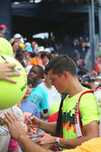 Professional tennis player Miols Raonic signing autographs after third round match at US Open 2014 — Stock Photo