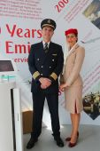 Emirates Airlines pilot and flight attendant at the Emirates Airlines booth at the Billie Jean King National Tennis Center during US Open 2014 — Stock Photo