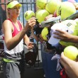 Постер, плакат: Five times Grand Slam champion Maria Sharapova signing autographs after practice for US Open 2014