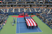 US Marine Corps unfurling American Flag  during the opening ceremony of the US Open 2014 men final — Stok fotoğraf