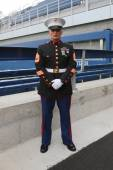 United States Marine officer at Billie Jean King National Tennis Center before unfurling the American flag prior US Open 2014 men final — Stockfoto