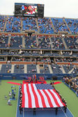 US Marine Corps unfurling American Flag  during the opening ceremony of the US Open 2014 men final — Stockfoto