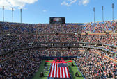 US Marine Corps unfurling American Flag  during the opening ceremony of the US Open 2014 women final — Stockfoto