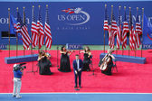 Nick Jonas sings God Bless America before the US Open 2014 Women's singles final — Stock Photo