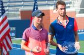 US Open 2014 boys junior champion Omar Jasika from Australia (left) and finalist Quentin Halys from France during trophy presentation — Stock Photo