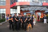 NYPD transit bureau K-9 police officers and K-9 dog providing security at National Tennis Center during US Open 2014 — Stock Photo