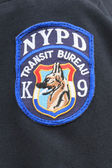 Close up of shoulder  patch of NYPD Transit Bureau K-9 Unit — Stock Photo