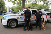 NYPD transit bureau K-9 police officers and K-9 dogs providing security at National Tennis Center during US Open 2014 — Stock Photo