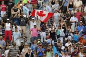 Canadian tennis fans celebrate win by  Miols Raonic after third round match at US Open 2014 — Stock Photo