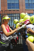 Five times Grand Slam champion Maria Sharapova signing autographs after practice for US Open 2014 — Stock Photo