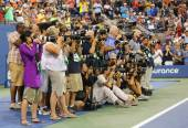 Professional photographers on tennis court during trophy presentation at the Arthur Ashe Stadium at Billie Jean King National Tennis Center — Stock Photo