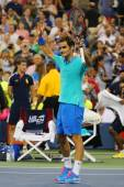 Grand Slam champion Roger Federer celebrates victory after third round match at US Open 2014 against Marcel Granollers — Stock Photo