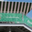 Постер, плакат: Third largest brewer in the world Heineken International opens Heineken Beer House at Billie Jean King Tennis Center during US Open 2014