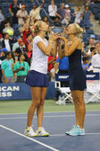 US Open 2014 women doubles champions Ekaterina Makarova and Elena Vesnina during trophy presentation — Stok fotoğraf