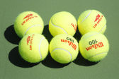 Wilson tennis balls on tennis court at Arthur Ashe Stadium — Stock Photo