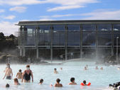 Visitors enjoying famous Blue Lagoon Geothermal Spa in Iceland — Stock Photo