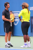 Sixteen times Grand Slam champion Serena Williams practices for US Open 2014 with her coach Patrick Mouratoglou at National Tennis Center — 图库照片