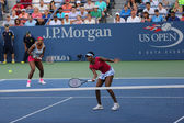 Grand Slam champions Serena Williams and Venus Williams during doubles match at US Open 2014 — 图库照片