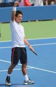 Professional tennis player Kei Nishikori celebrates victory after first round US Open 2014 — Stock Photo