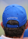 Tennis fan wears  Roger Federer hat during US Open 2014 semifinal match — ストック写真