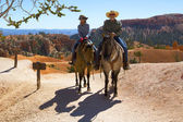 Tourists ride horses on horse trial at Bryce Canyon National Park in Utah — Stock Photo