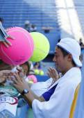 Professional tennis player Kei Nishikori signing autographs after practice for US Open 2014 at Billie Jean King National Tennis Center — Stock Photo