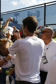 Seventeen times Grand Slam champion Roger Federer signing autographs after practice for US Open 2014 at Billie Jean King National Tennis Center — Stock Photo