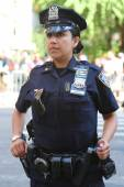 NYPD officer providing security during LGBT Pride Parade in NY — Stock Photo
