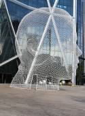 Wonderland sculpture by Jaume Plensa in the front of the Bow Tower in Calgary — Stock fotografie