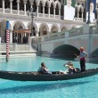 Unidentified people enjoy gondola ride at Grand Canal at The Venetian Resort Hotel Casino — Stock Photo #60244709