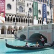 Unidentified people enjoy gondola ride at Grand Canal at The Venetian Resort Hotel Casino — Stock Photo #60244717
