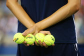 Ball boy holding tennis balls at the Billie Jean King National Tennis Center during US Open 2014 — Stock Photo