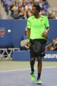 Professional tennis player Gael Monfis during quarterfinal match against seventeen times Grand Slam champion Roger Federer at US Open 2014 — Stock Photo