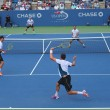 Grand Slam champions Mike and Bob Bryan (at the front) during US Open 2014 round 3 doubles match — Stock Photo #62754577
