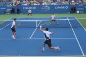Grand Slam champions Mike and Bob Bryan (at the front) during US Open 2014 round 3 doubles match — Stock Photo