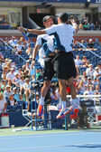Grand Slam champions Mike and Bob Bryan celebrating victory after semifinal doubles match at US Open 2014 — Stock Photo
