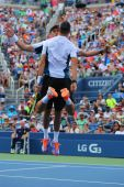 Grand Slam champions Mike and Bob Bryan celebrating victory after round 3 doubles match at US Open 2014 — Stock Photo