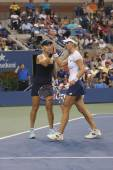 US Open 2014 women doubles champions Ekaterina Makarova and Elena Vesnina during final match — Stock Photo