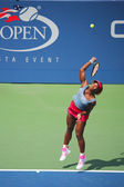 Grand Slam champion Serena Williams during quarterfinal doubles match at US Open 2014 — Stok fotoğraf