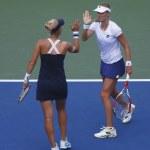 Постер, плакат: US Open 2014 women doubles champions Ekaterina Makarova and Elena Vesnina during quarterfinals match