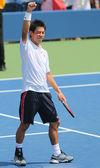 Professional tennis player Kei Nishikori celebrates victory after first round US Open 2014 match — Stock Photo